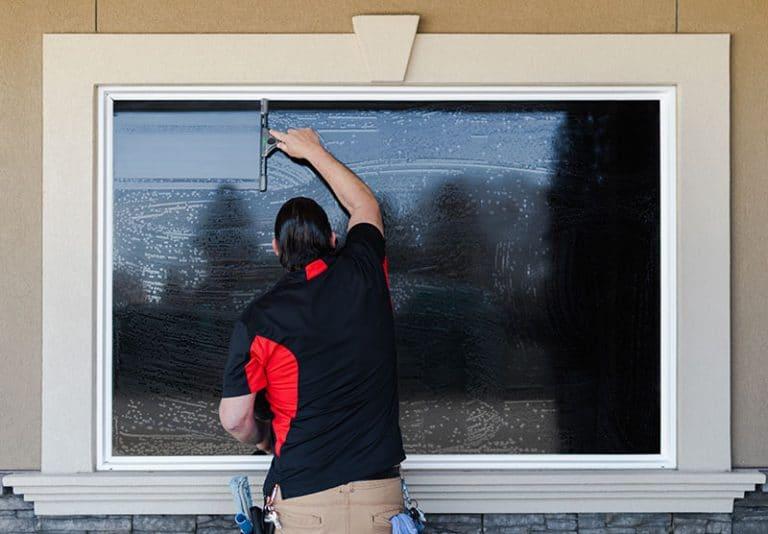 Dura-shine employee conducts window cleaning